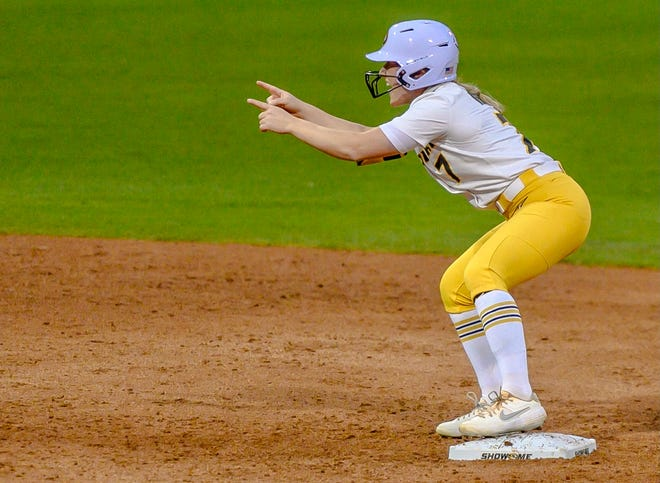 Missouri's Brooke Wilmes (7) points to the bench after hitting a double during a game against LSU on Friday night at Mizzou Softball Stadium.