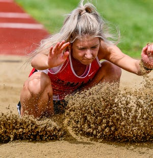 "Sophomore Isabella ""Belle"" Englert of the Chillicothe High School track-and-field Lady Hornets lands on one of her attempts in the long jump. She finished second in the event with a best try of 15'4"" and also took fourth in the triple jump, helping lead the CHS girls to the team title of the Chillicothe Joe Shy Relays meet last Friday."