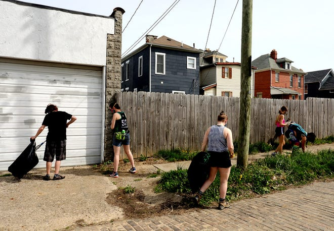 Members of the  Ohio Roller Derby league were among about 15 volunteers who joined a cleanup Saturday, organized by the nonprofit volunteer group Green Columbus as part of its Earth Day Columbus effort.