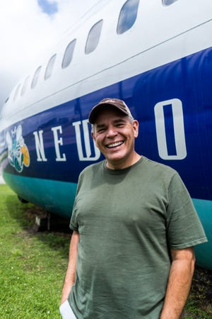 Andy Cook stands outside the Boeing 727 he renovated after it was exposed to the elements for two years in a shipyard.