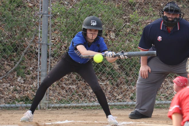 Cambridge's Madisyn Mickey (9) attempts to lay down a bunt during Friday's game at St. Clairsville.