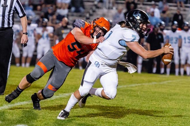 North Davidson's Collin Cumming sacks Oak Grove quarterback Dylan Barker. [Brad Arrowood/Brad Arrowood Photography]