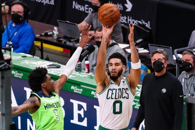 Apr 9, 2021; Boston, Massachusetts, USA; Boston Celtics forward Jayson Tatum (0) shoots while defended by Minnesota Timberwolves forward Jaden McDaniels (3) during the second half at TD Garden.