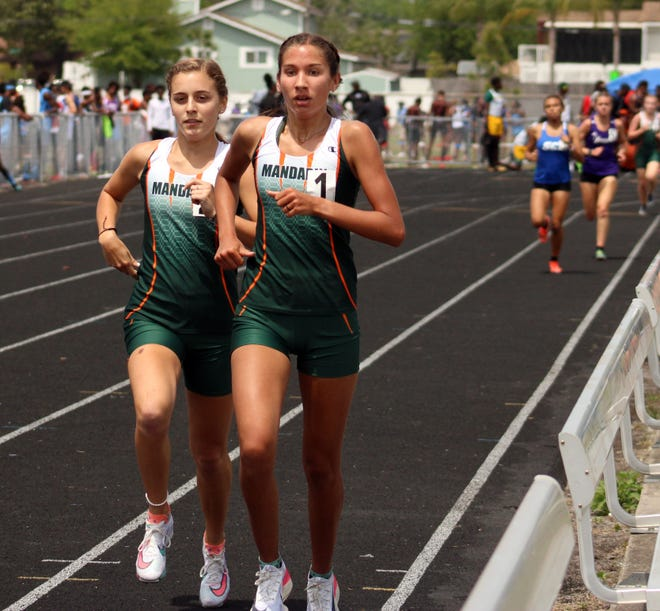 Mandarin's Lindsay Gonzales (1) and Lauren Conover lead the field during the girls 1,600-meter run during the Gateway Conference track meet.