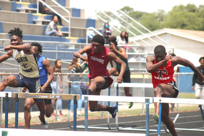 Sandalwood's Christian Washington, Raines' Harrison Robinson and Parker's Desmyn McCall clear the hurdles in the boys 110-meter hurdles at the Gateway Conference track and field championships on April 9, 2021. [Clayton Freeman/Florida Times-Union]