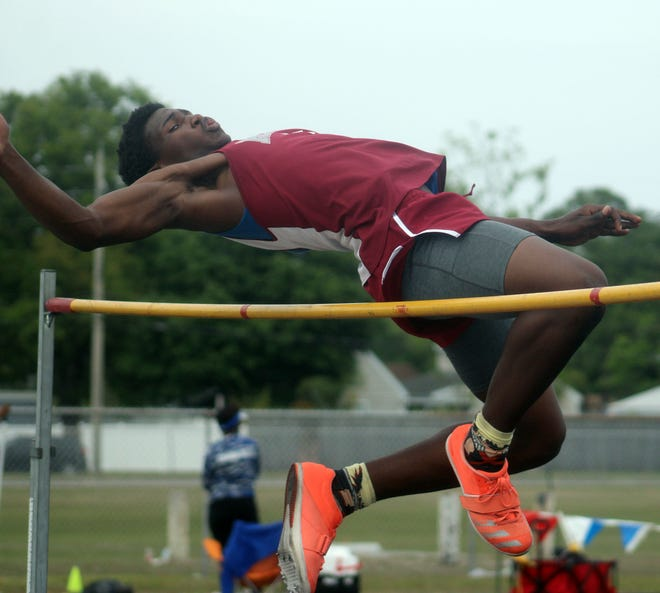 Jacoby Johnson of Raines attempts to clear the bar in the boys high jump at the Gateway Conference track and field championships on April 9, 2021. [Clayton Freeman/Florida Times-Union]