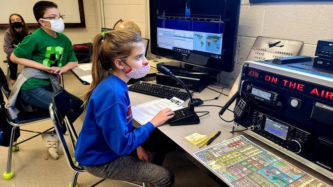 Students in the Falcon Radio Club at W.B. Intermediate School use ham radio equipment.