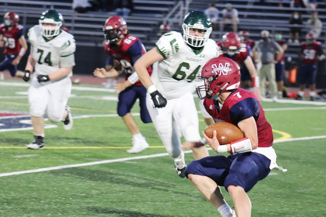 Oakmont's Joey Sibley (64) moves in toward Westboro's Ashton Worstell, who scored three touchdowns for the Rangers in their 43-36 victory over the Spartans, Friday evening, in Westboro.