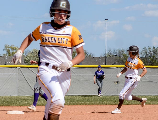 Garden City Community College's Lacey Kearsley, left, head to third base as teammate Tara Reid runs to second base Thursday against Dodge City at Tangeman Sports Complex.