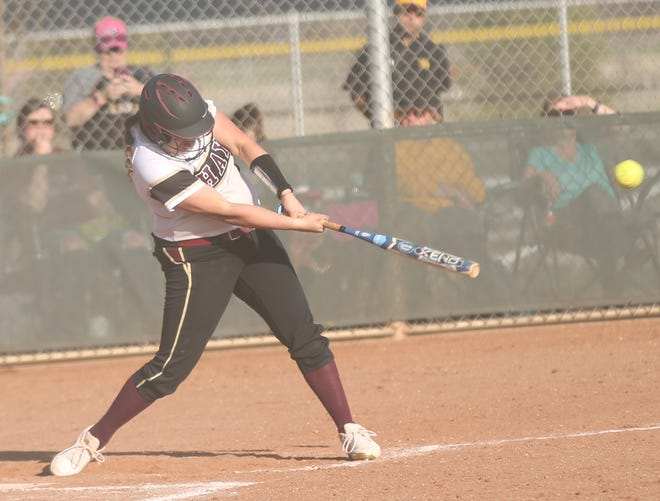 Hays High's Brenna Schwien connects with a pitch for a hit during Thursday's doubleheader against Dodge City.