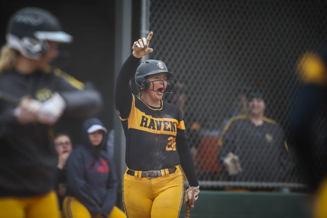Haven's Maguire Estill cheers from the dugout after the Wildcats score runs in their doubleheader against Larned.
