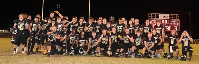 The Croatan football team celebates its outright Coastal 8 1-A/2-A Conference title Friday night following a 44-29 victory over East Carteret. [Andy Marquis]