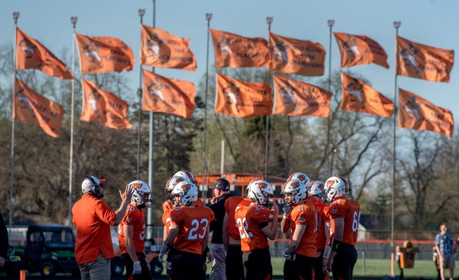 The Washington Panthers prepare to take the field against Pekin on Friday, April 9, 2021 in Washington.