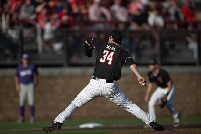 Texas Tech starting pitcher Micah Dallas attempts to throw a ball during a Big 12 Conference game Friday, April 9, 2021, against TCU at Dan Law Field at Rip Griffin Park.