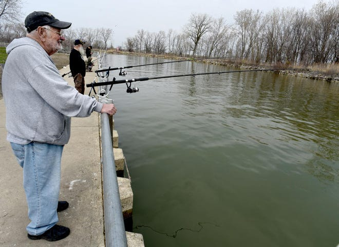 """Bill Fehse, 76, (foreground) of Monroe and his fishing buddy, Chuck Penrod, 68, of Monroe fish daily at Hoffman Memorial Access Site in Bolles Harbor. """"We will fish every day, except if it is windy,"""" said Fehse. """"We usually try to catch perch, hopefully larger than 8 inches,"""" said Penrod. """"It is really nice when a boater comes in and hands us a few walleye,"""" Penrod chuckled."""