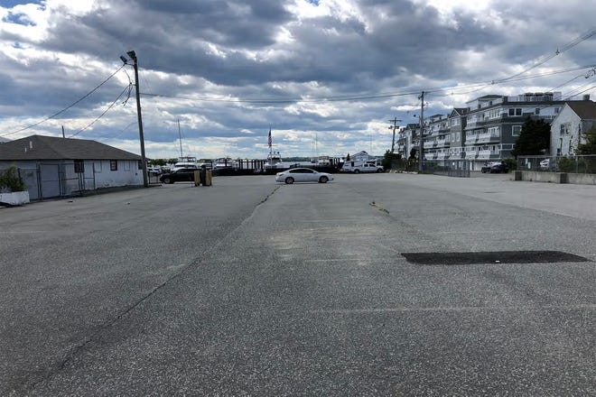 The Manchester Hotel is expected to be built in a vacant parking lot on Lee's Wharf in Newport.