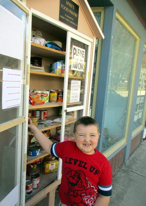 Noah Walker of Vernon makes a donation to Spike's Food Pantry April 4 in Oriskany Falls. The Alberding family created the pantry in memory of Aubrey 'Spike' Alberding III and appreciate the support of all of their donors.