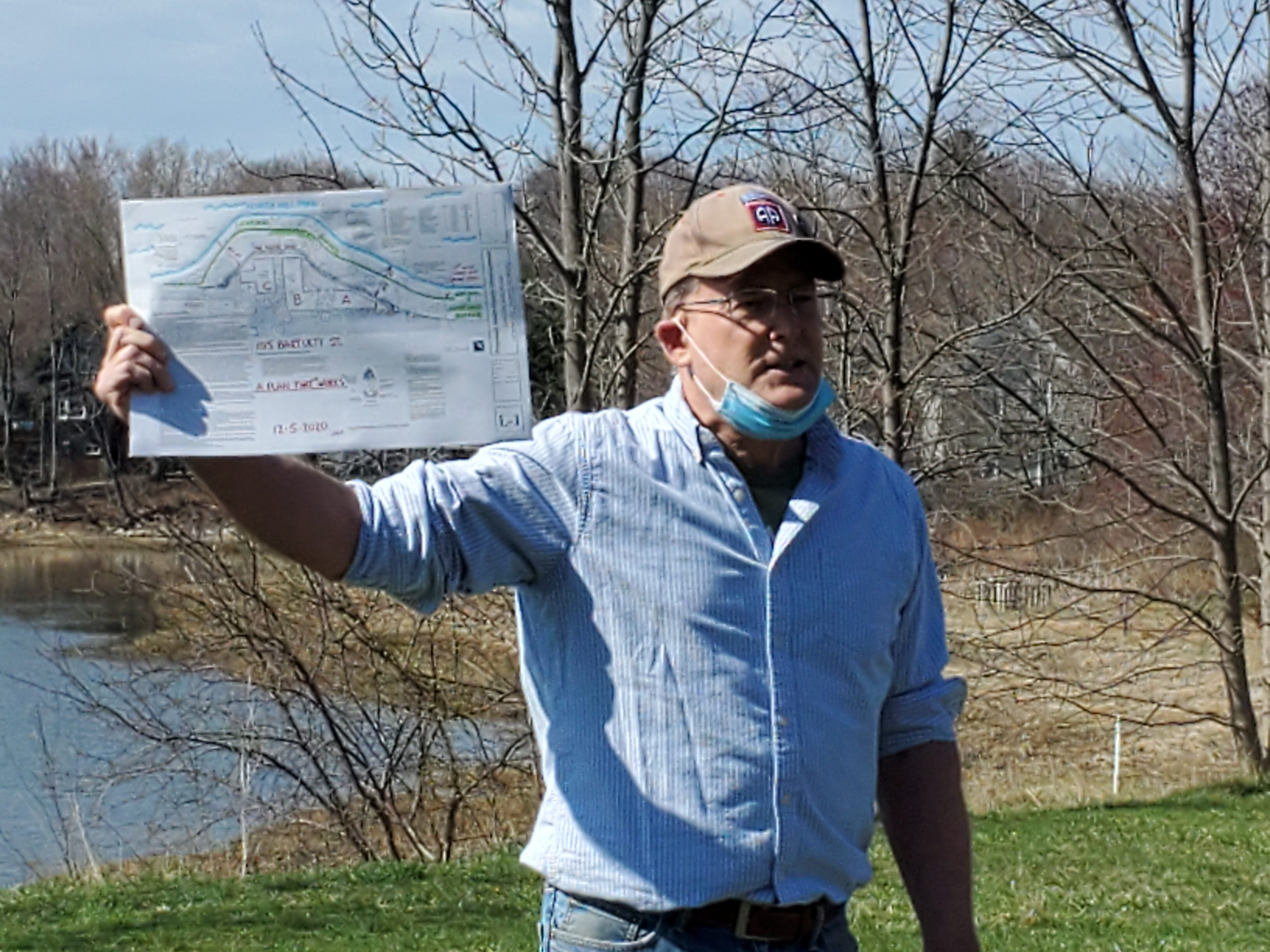 Jim Hewitt, Portsmouth resident and abutter to a project that would add 152 apartments to the shores of the North Mill Pond, called during an event Saturday, April 10, 2021, for the project to keep a 100-foot buffer from the pond.