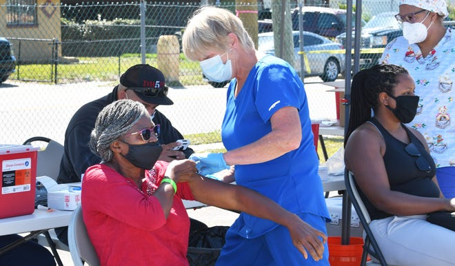 Roselyn Elmondo, 70, of Palm Bay receives the vaccine. A State of Florida mobile COVID vaccination unit and CDR Maguire were providing the single shot Johnson & Johnson vaccine near Lipscomb Park Community Center in Melbourne April 5th. They began at 8:45am, and had 400 shots to give for ages 18 and up.  Vaccine Mobile Unit Visits Melbourne