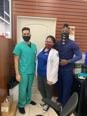 From left: Belle Glade Pharmacy owner Dhruvang Patel, intern Devora Bustamante of Palm Beach Atlantic University and pharmacy tech Povensky Pierre.
