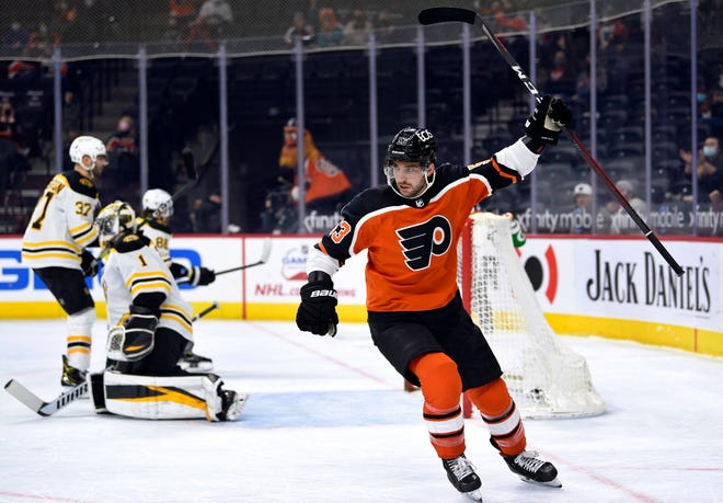 The Flyers' Shayne Gostisbehere celebrates after scoring a goal on Bruins goaltender Jeremy Swayman during the first period of Saturday's game in Philadelphia.