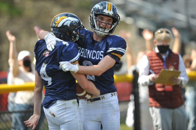 Burrillville's Ben DiChiaro, left, is congratulated by teammate Jake Bergin after DiChiaro's 11-yard touchdown catch in the second quarter of Saturday's win over East Providence.