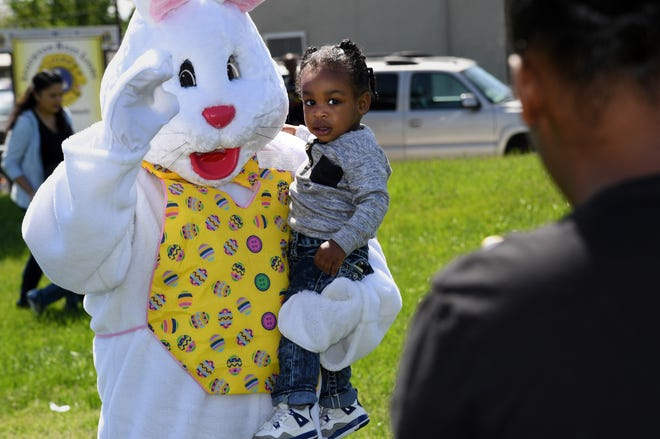 One-year-old Oscar Killion gets his picture taken with the Easter Bunny at the the Sierra Vista Residents Association's Easter celebration April 14, 2017, at Nancy Patron Park in south Stockton.