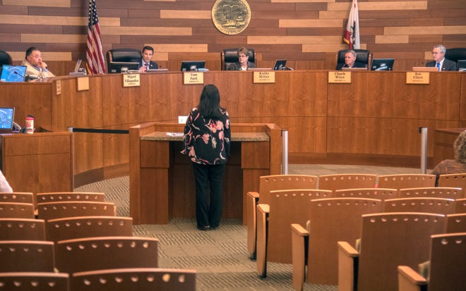 (3/17/20)  San Joaquin County Board of Supervisors listens to interim county public health officer Dr. Maggie Park give information about the Covid-19 virus during a board meeting at the San Joaquin County administration building in downtown Stockton.  [CLIFFORD OTO/THE RECORD]