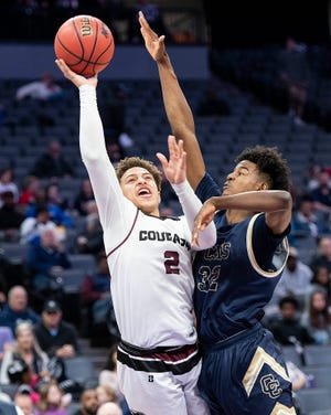Weston Ranch's Mison Coilton drives to the basket against Central Catholic's Myles Clayton in the Sac-Joaquin Section Boys Division III championship game Saturday at the Golden One Center in Sacramento. [CRAIG SANDERS/STOCKTON RECORD FILES]