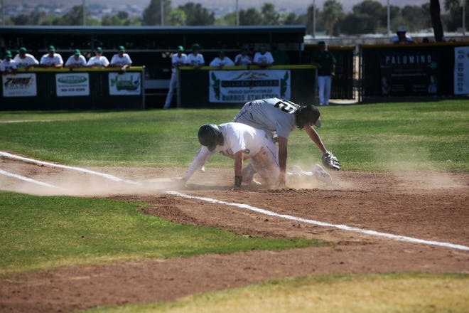Close call! The Burroughs runner was called safe at first after the Scorpion's pitcher tried throwing him out at first base.