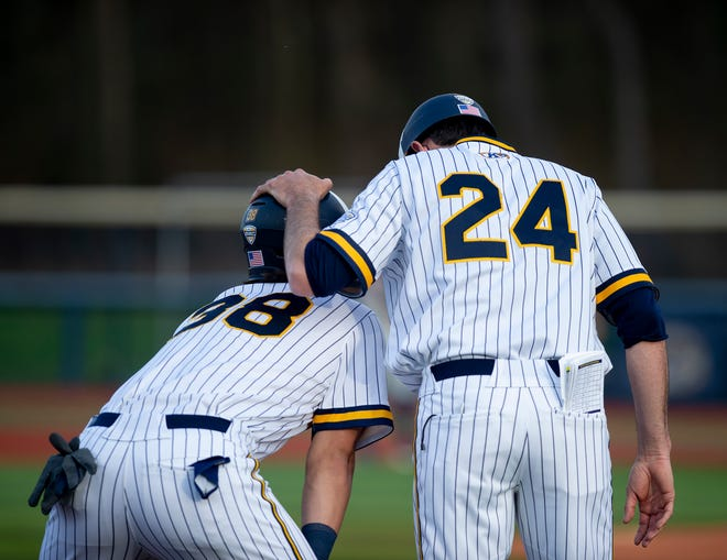 Kent State head coach Jeff Duncan (No. 24) chats with freshman Michael McNamara during a victory over Toledo last month at Schoonover Stadium.