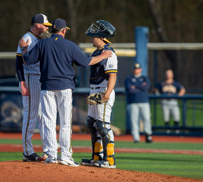 Veteran Kent State pitching coach Mike Birkbeck is pictured chatting with ace junior pitcher Luke Albright and sophomore catcher Justin Miknis during last Friday's game against Toledo at Schoonover Stadium. Albright is having a great 2021 season, but the rest of the Golden Flashes staff had considerable trouble retiring Rockets batters last weekend.