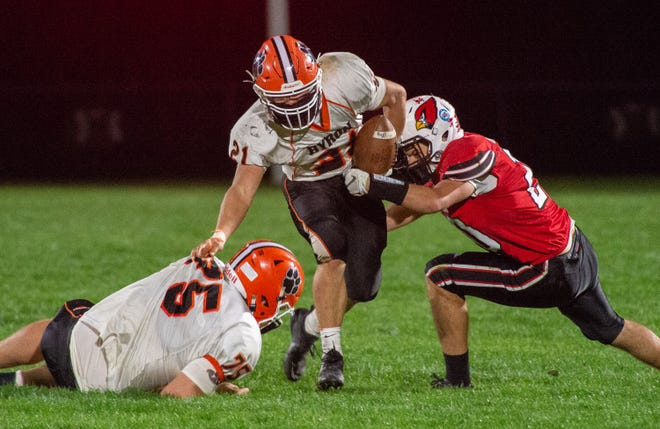 Byron's Chandler Binkley, the Big Northern Conference's leading rusher this season, tries to break free from Stillman Valley's Carson Engelkes during their game on Friday, April 9, 2021, in Stillman Valley. Byron won 31-14.
