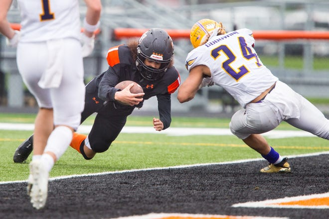 Harlem's Dezzion Jordan dives into the end zone past Hononegah's Bryce Goodwine in the second quarter of their NIC-10 game at Harlem High School Saturday, April 10, 2021, in Machesney Park.