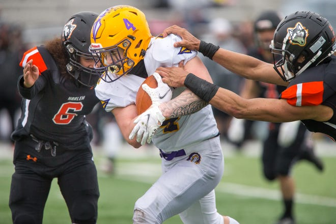 Hononegah's Dylan Collins is tackled by Harlem's Dezzion Jordan, left, and Dominic McCarren, right, in the second quarter of their NIC-10 game at Harlem High School Saturday, April 10, 2021, in Machesney Park.
