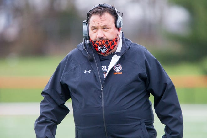 Harlem's Bob Moynihan, shown during a comeback win over Hononegah on April 10, was named the Chicago Bears coach of the week in high school football Tuesday.