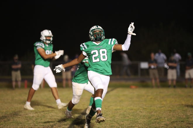 Ashbrook's Lamonte Allen celebrates after a late touchdown in the Battle for the Bell against crosstown rival Hunter Huss. The Green Wave defeated the Huskies 30-17 to claim the bell.