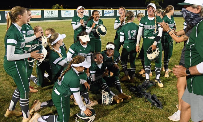 Venice celebrates a win over Charlotte 16-6, winning by the ten run rule. Photographed Friday, April 9, 2021.