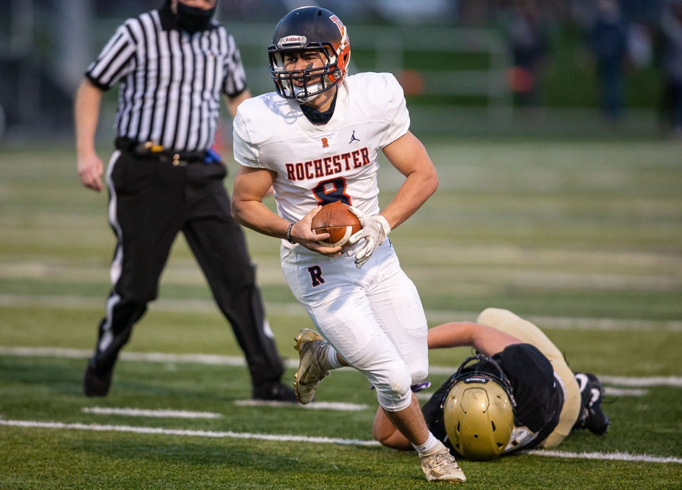 Rochester's Hank Beatty (8) avoids a tackle from Sacred Heart-Griffin's Peyton Fay (8) in the first half at Ken Leonard Field in Springfield, Ill., Friday, April 9, 2021. [Justin L. Fowler/The State Journal-Register]