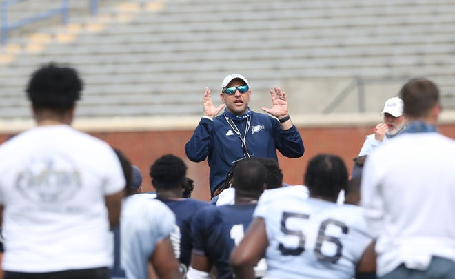 Georgia Southern coach Chad Lunsford talks to the team following the team's first scrimmage of the spring on April 10 at Paulson Stadium in Statesboro.