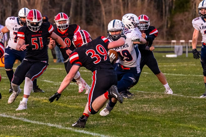 Apponequet's Kevin Hughes cuts around Old Rochester's Walter Rosher earlier this season. The Lakers and Bulldogs face one another Saturday for the South Coast Conference Blue Division championship.