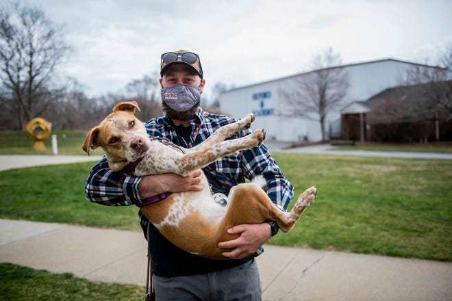 Cody Forrest holds 1-year-old cattle dog/ Pitbull mix, Rhea, at their home Wednesday, March 31, 2021, in Westbrook.