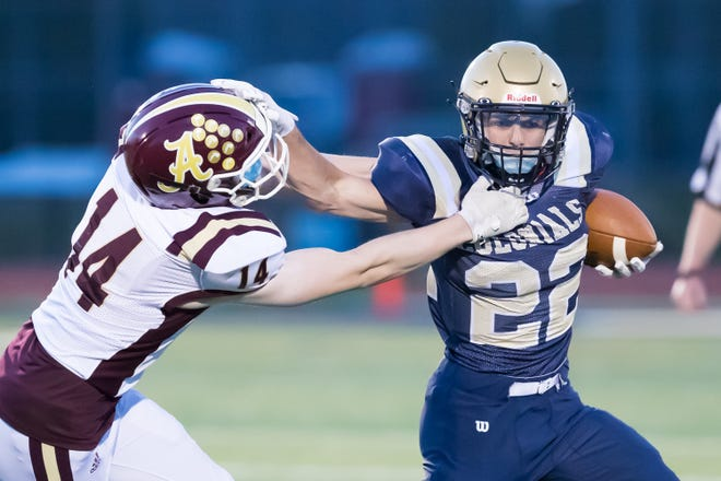 Shrewsbury's Jamison Alicandro carries the ball as he holds off Algonquin's Aidan McKenna, Friday, April 9, 2021.