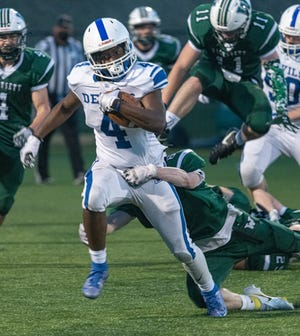 Leominster RB Voshon Dixon makes a run against Wachusett Friday night, April 9.
