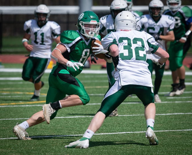 Sutton's Aidan Royce moves upfield against Bartlett's Bryce Patterson during Saturday's game.