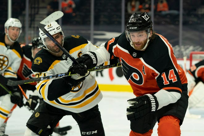 Bruins center Patrice Bergeron (37) battles with Flyers center Sean Couturier, who scored the winner for Philadelphia in the third period.