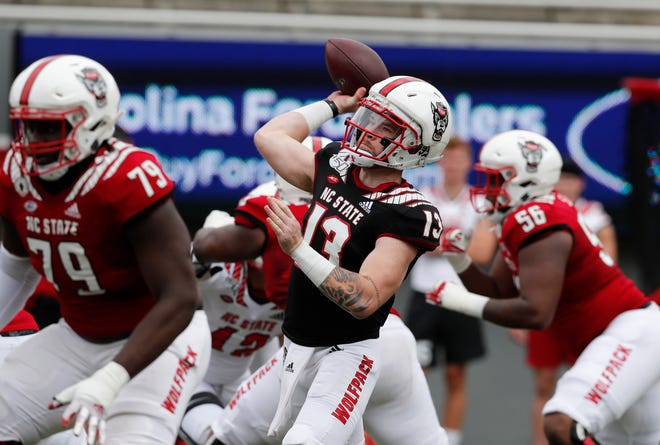 N.C. State quarterback Devin Leary (13) passes during the first half of N.C. State football's spring game at Carter-Finley Stadium in Raleigh, N.C., Saturday, April 10, 2021.