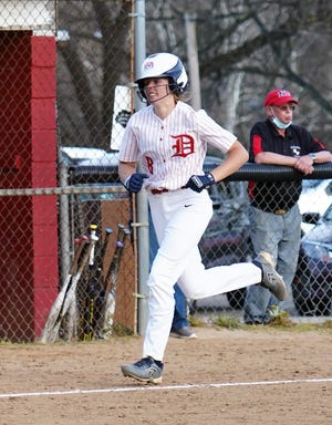Dover's Maddie DeVault rounds third and heads for home after her solo blast in the 9th inning.