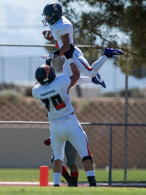 Apple Valley's Damian Guillen is lifted into the air by Isaiah Mendoza after scoring a touchdown against Oak Hills on Saturday, April 10, 2021. The Sun Devils won 35-7.