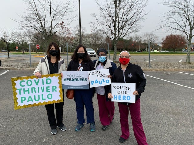 Members of the staff at CentraState Healthcare System, Freehold, send Paulo Santos off on his 20-mile run Saturday.